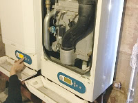 An engineer repairing a Commercial Boiler