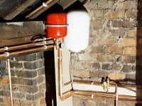 Hot water cylinder fitted in loft area.
