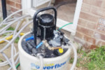 Power flushing a central heating system to remove sludge and blockages